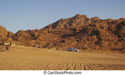 Pickup truck moves Through the Desert in Egypt, on Sand and...