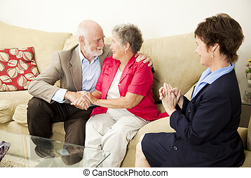 Couples Counseling - Happy Outcome - Therapist looks on as a...
