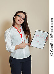 Young female bookkeeper shows accounting documents - Young...
