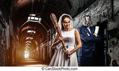 Newlyweds maniacs, old prison on background - Newlyweds...