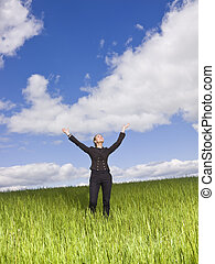 Young woman with her arms raised outdoor