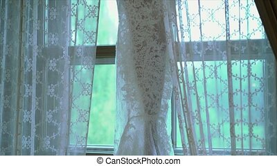 Wedding dress indoors on window