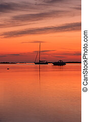 Morning on Sardinia - A fishing boat in shallow water