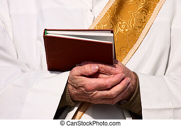 Religion - Folded hands of a priest