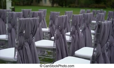 Chairs on wedding ceremony outdoors at cloudy day