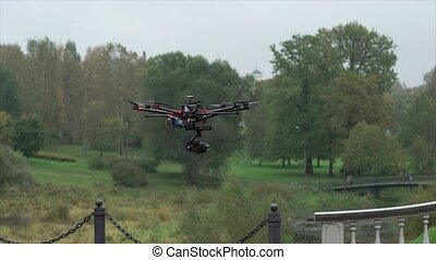 Drone flying with dslr camera at cloudy day