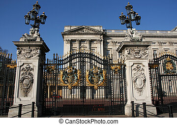Buckingham Palace decorated metal gate. Coat of arms. Famous...