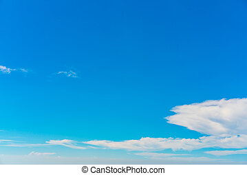 Cloud in blue sky .