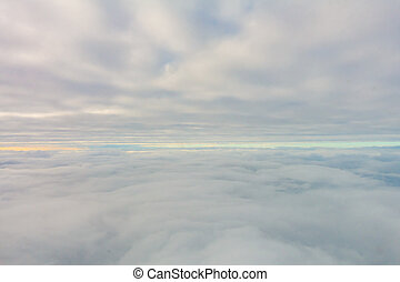 Sunrise above clouds from airplane window . - Sunrise above...