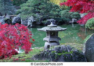 Stone Temple In a Japanese Garden With Fall Colors