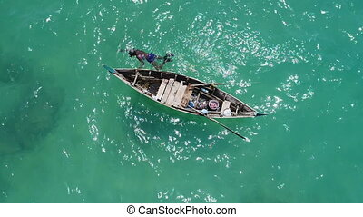 Sea, boat and fisherman in the water - Aerial top view of...