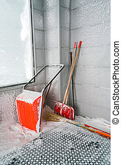 Orange Snow removal. Shovel in snow . - Orange Snow removal....