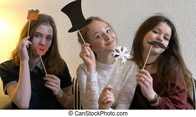 Three beautiful girls. Together, they spend leisure time....