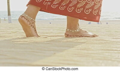Macro Girl Feet in Long Walks Barefoot on White Sand Beach -...