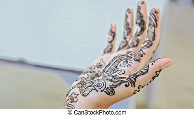Closeup Girl Shows Patterns with Henna on Palm Wrist Arm -...