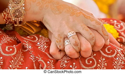 Happy Newlyweds United Hands with Wedding Rings on Fingers -...