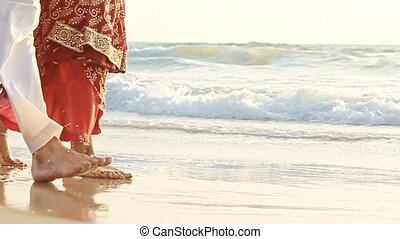 Closeup Bride in Long Groom Walk Barefoot in Shallow Water