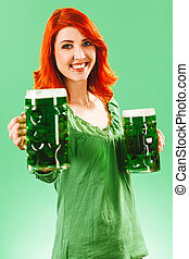 Redhead woman with two huge green beers