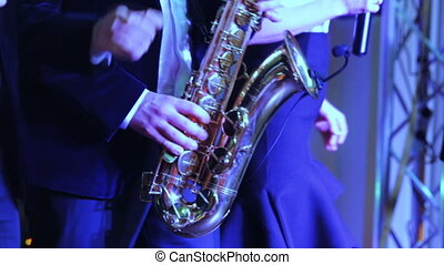 Man playing saxophone - Musicians man playing saxophone on...