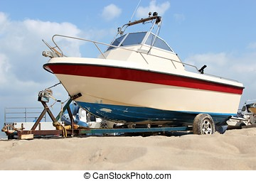 motorboat on trailer at sandy beach