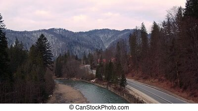 Car Driving on Curvy Country Road - Flying over the road in...