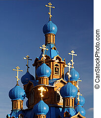 Wooden Orthodox Church with Blue Domes