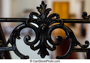 Vintage old black wrought-iron openwork railing staircase or...