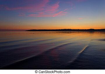 Scenic sunset over ocean beach