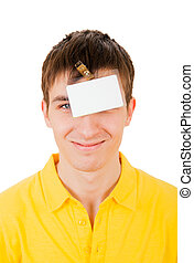 Young Man with Empty Badge on his Head Isolated on the White...