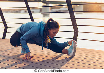 Woman streching after training outdoors