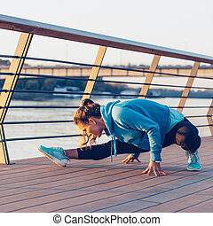 Woman streching after jogging - Woman streching after...