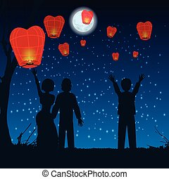 let people silhouette sky lanterns into the sky - Thailand,...