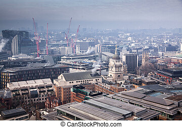 rooftop view over London on a foggy day from St Paul's...