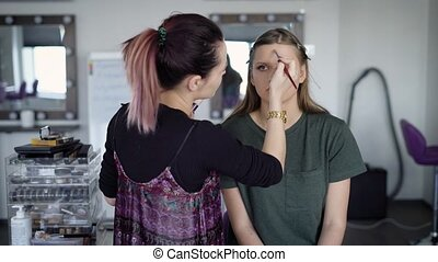 Working process of make-up applying at beauty studio....