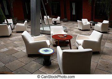 Cafe interior - Cafe indoor with white sofas and blue glass...