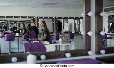 Interior of luxury beauty salon with expert standing and...