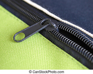 Zipper or zip fastener joining two edges of fabric