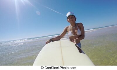 Smiling woman with surfboard - Cheerful young pretty female...