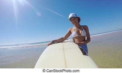 Woman walking with surfboard - Happy young beautiful female...
