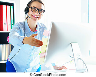 Close-up of woman working in a call center