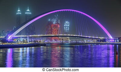 Pedestrian Bridge over the Dubai Water Canal night timelapse, United Arab Emirates