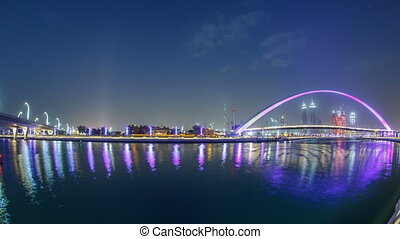 Pedestrian Bridge over the Dubai Water Canal day to night timelapse, United Arab Emirates