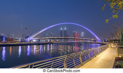 Pedestrian Bridge over the Dubai Water Canal day to night...