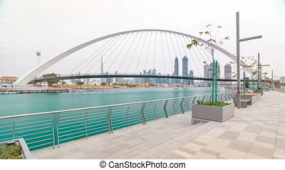 Pedestrian Bridge over the Dubai Water Canal day timelapse,...