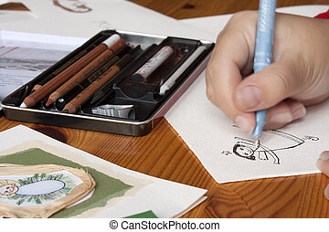 Illustrator at work - using ink pen and paper