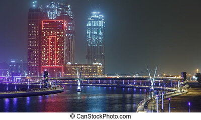 The new Dubai Water Canal with view on the city skyline...