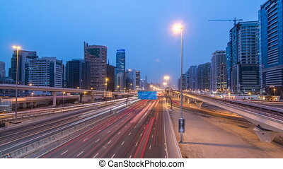 Sheikh Zayed road traffic day to night timelapse and Dubai Metro. Dubai, UAE.