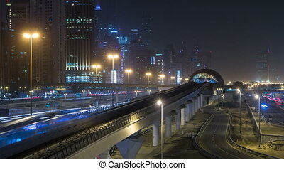 Sheikh Zayed road traffic night timelapse and Dubai Metro. Dubai, UAE.