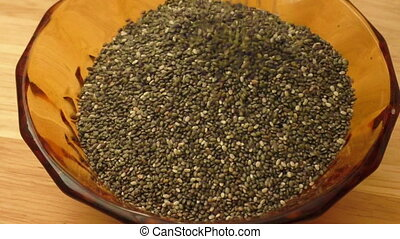 Chia seeds in brown bowl