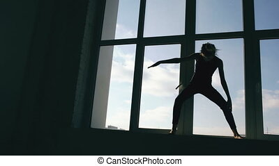 Silhouette of young girl dancer perfomance contemporary...